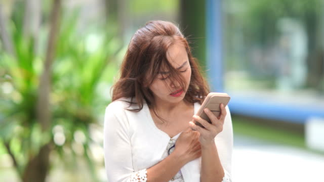facial expression by mature businesswoman , heart attack, using phone for rescue