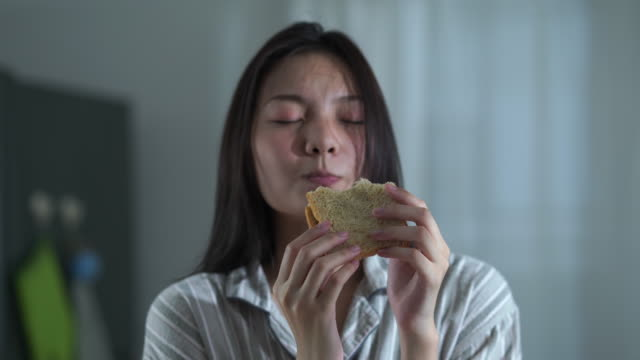 facial expression by young woman in purity morning time , cooking and eating sandwich - sandwich stock videos & royalty-free footage