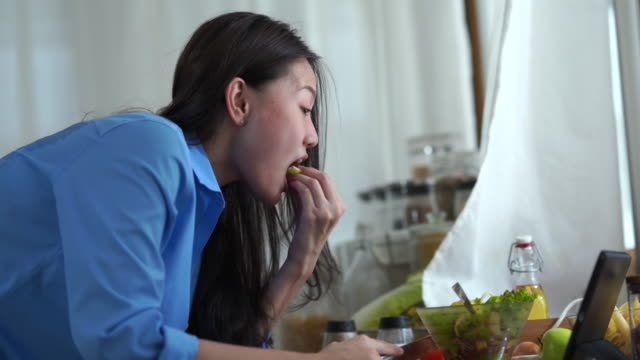 facial expression by young woman in purity morning time , cooking food  while using digital tablet - antioxidant stock videos & royalty-free footage