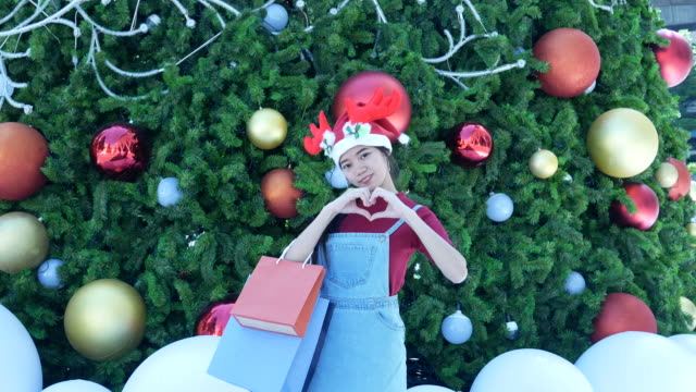 facial expression , heart sign by young woman in christmas time - short phrase stock videos & royalty-free footage