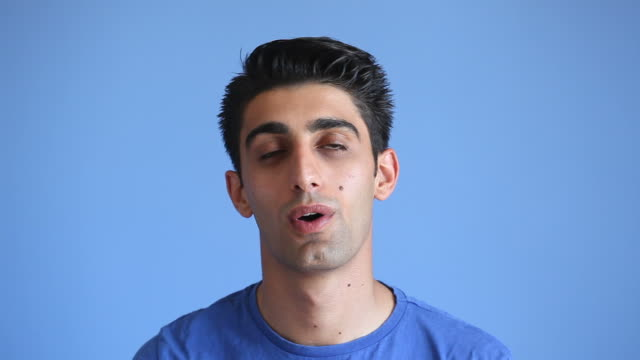 Facial Expression Of Satisfied Adult Man On Blue Background