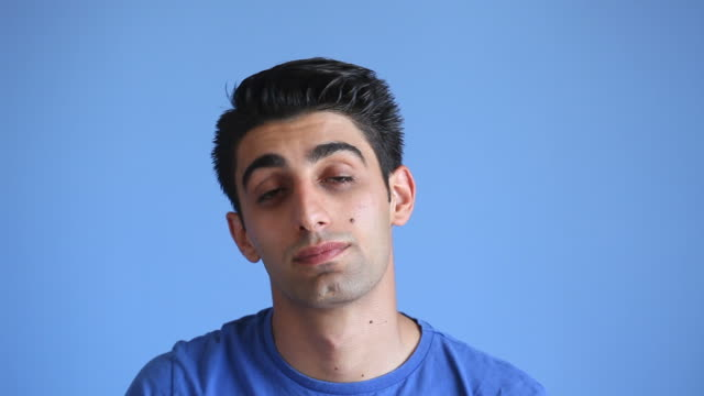 Facial Expression Of Sleeping Adult Man On Blue Background