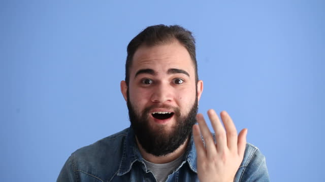 Facial Expression Of Surprised Adult Man On Blue Background