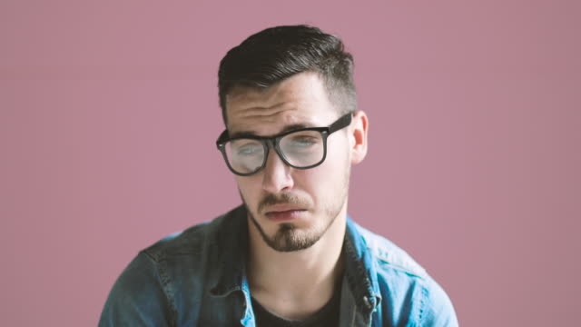facial expressions collection of adult man on pink background - boredom stock videos and b-roll footage