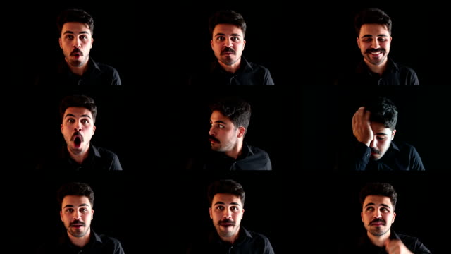 facial expressions montage of young man on black background - selimaksan stock videos & royalty-free footage