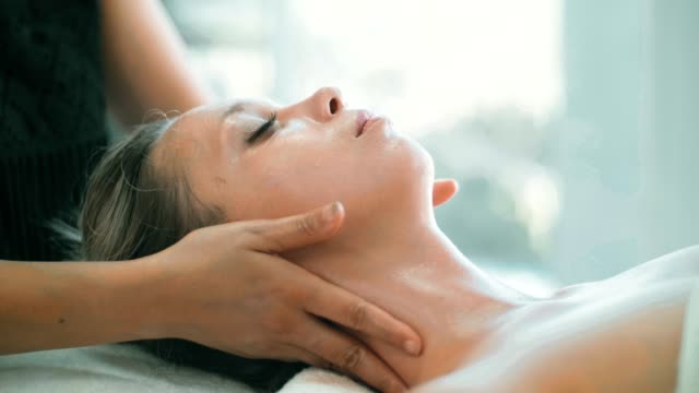 cu : facial massage of beautiful woman - spa treatment stock videos & royalty-free footage