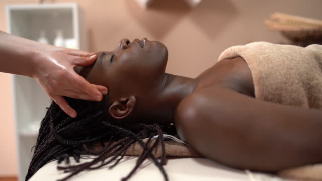 facial massage treatment - stock video 4k - grooming product stock videos & royalty-free footage