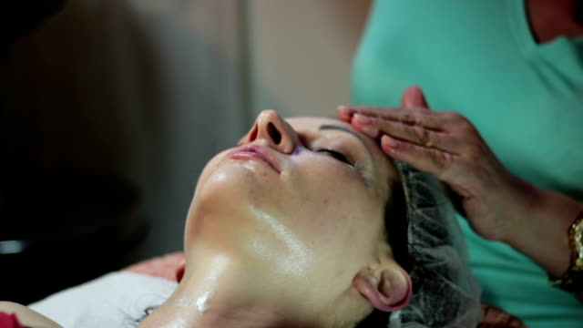 facial massage - head massage stock videos and b-roll footage