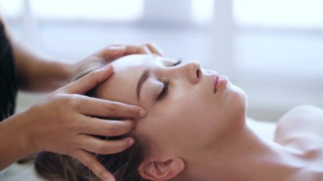 cu : facial massage - head massage stock videos and b-roll footage
