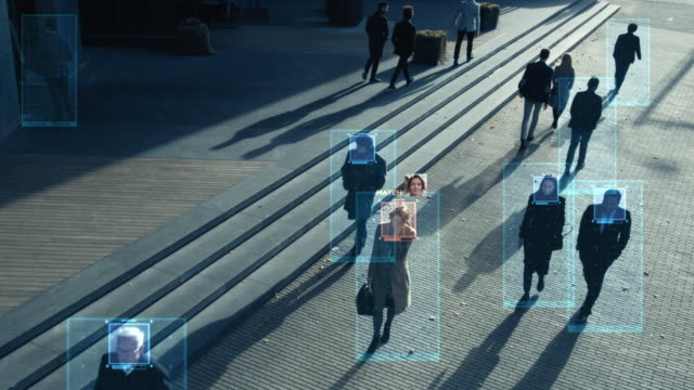 CCTV AI Facial Recognition Camera Zoom in Recognizes Person. Elevated Security Camera Surveillance Footage Face Scanning of a Crowd of People Walking on Busy Urban City Streets. Big Data Analysis
