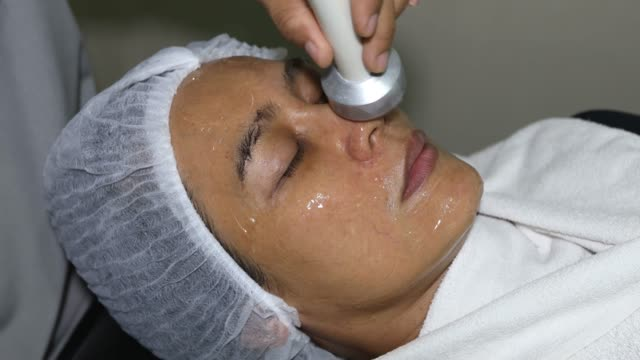 facial treatment - beauty spa stock videos & royalty-free footage