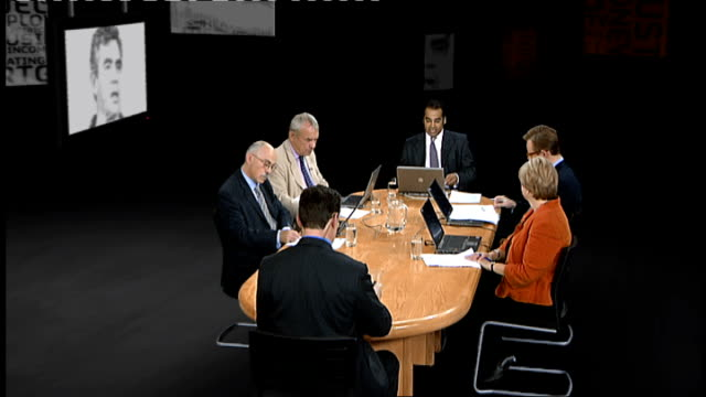 the future for brown's labour party england london gir int reporter to camera general view of panellists gathered round table facing the crunch... - round table discussion stock videos & royalty-free footage