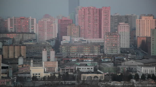 factories and apartment buildings fill the cityscape of pyongyang, north korea. - north korea stock videos & royalty-free footage