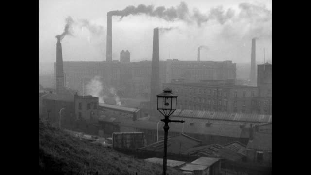 factories and smoking industrial chimneys; london, 1963 - 1963 stock videos & royalty-free footage