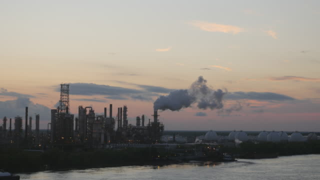 factories spread out along the mississippi river outside the city of new orleans, usa. - river mississippi stock videos & royalty-free footage