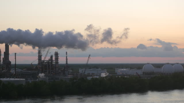 Factory and Smoke at Sunset By the River