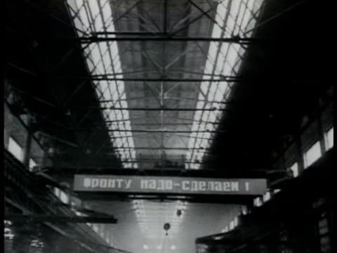 Factory banner on moving forward overhead crane 'The Front Needs it We Will Do it' The Great Patriotic War WWII