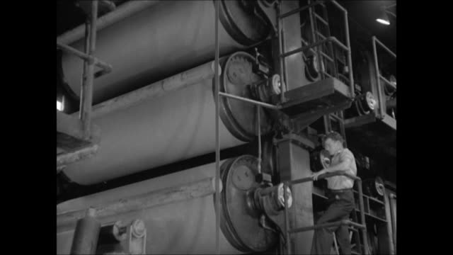factory building int ms chemist dr charles holmes herty mixing chemicals in laboratory la ws paper roller machines factory worker ext ws stacks of... - pappersbruk bildbanksvideor och videomaterial från bakom kulisserna