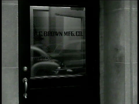 factory building smoke stack ms factory owner 'mr brown' entering office doors 'ac brown co' dramatization int vs 'mr brown' talking w/ assistant... - telegram stock videos and b-roll footage