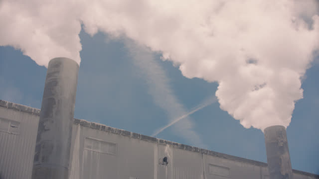 factory cooling tower and smokes - industrial district stock videos & royalty-free footage
