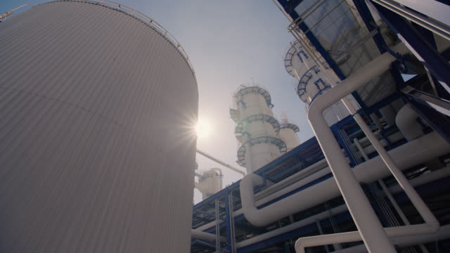 factory cooling tower and sunlight - oil refinery stock videos & royalty-free footage