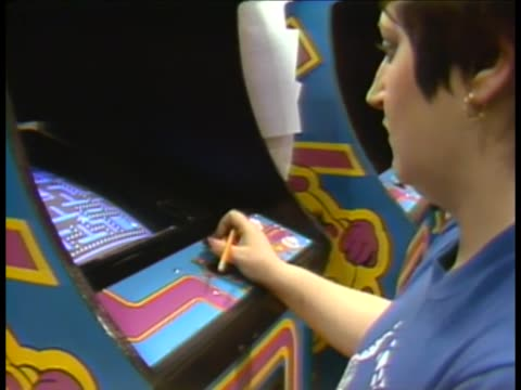Factory employees testing Ms PacMan games