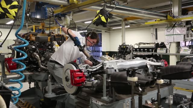 factory employees work on the body of a bentley continental gt automobile as it travels along the production line at the bentley motors ltd. workshop... - plant process stock videos & royalty-free footage