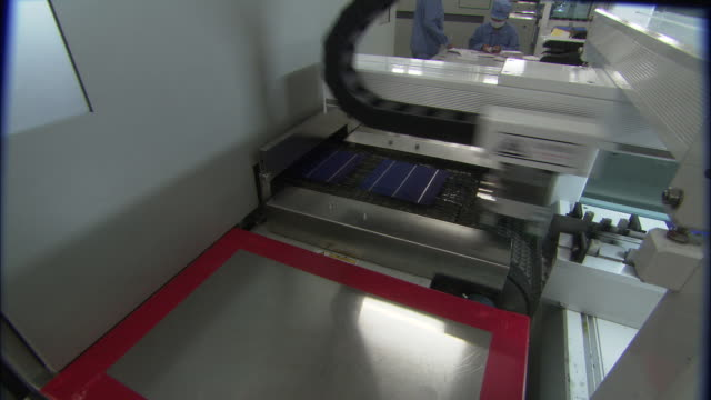 ws factory equipment manufacturing solar photovoltaic cells at suntech power holdings, wuxi, jiangsu, china - power equipment stock videos & royalty-free footage