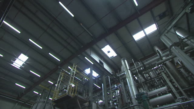factory interior, ceiling and pipes, england, united kingdom - pipe stock videos & royalty-free footage