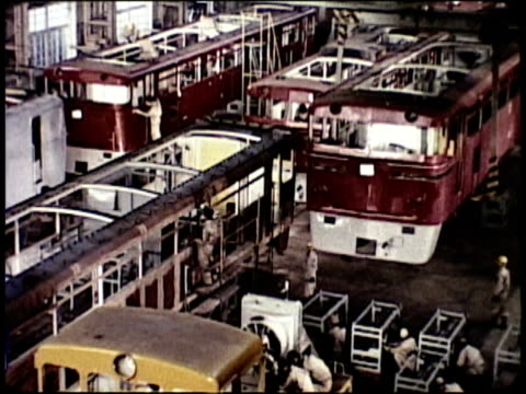 stockvideo's en b-roll-footage met 1963 montage factory interior with assembly line production of rail cars; cranes loading rail carriages to freighter / japan  - 1963