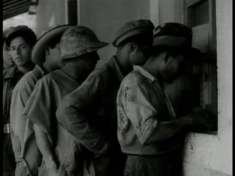 vídeos de stock e filmes b-roll de factory mill vs mexican factory workers at pay cash window ext ms group of workers walking ms president lazaro cardenas w/ crowd shaking man's hand... - 1935