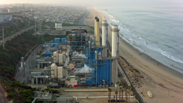 aerial factory on the sandy beach in california, usa - power station stock videos & royalty-free footage
