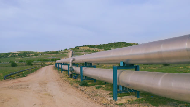 factory pipeline in nature - aerial view - pipe stock videos & royalty-free footage