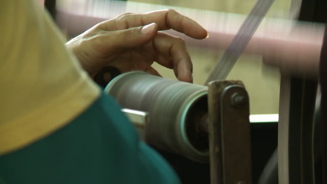 factory production of silk yarn on spinning wheel - ball of wool stock videos & royalty-free footage