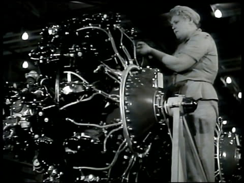 Factory smoke People leaving factory INT Aircraft factory hanger airplane woman working on motor woman w/ machine young woman at lathe DRAMATIZATION...