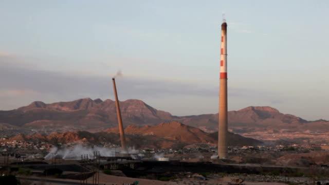 factory smoke stack chimney demolition - smoke stack stock videos & royalty-free footage
