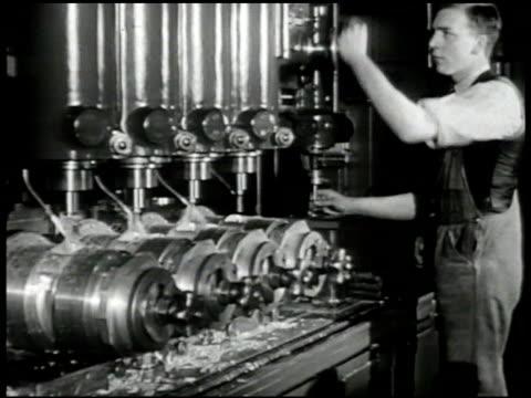factory smoke stacks int ms english man operating drill press cu worker w/ machine cu woman operating machine ms man w/ welding machine sparks... - 製造工場点の映像素材/bロール
