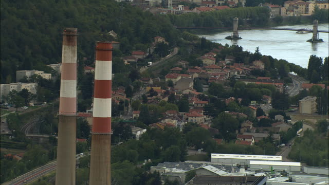 aerial ws factory smoke stacks overlooking town of vienne along rhone river / isere, france - rhone river stock videos & royalty-free footage
