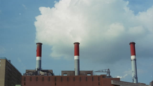 1969 montage factory smokestacks/ brooklyn, new york, usa - smoke stack stock videos & royalty-free footage