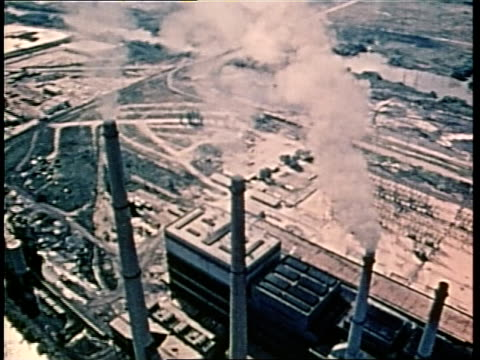 factory smokestacks emit steam and smoke - 1970 stock videos & royalty-free footage