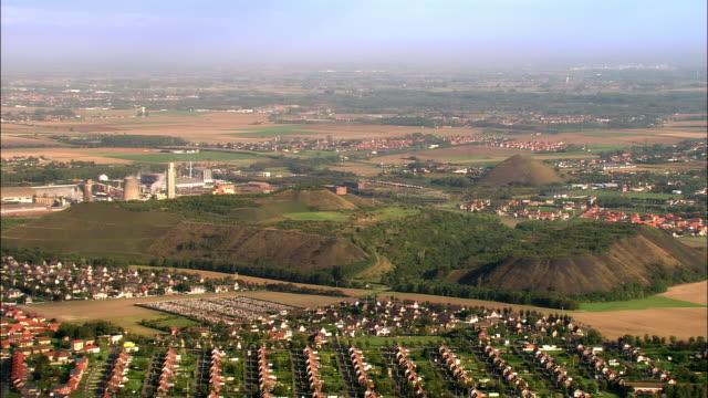 aerial factory, town, and slag heaps/ lens, france - lens pas de calais stock videos & royalty-free footage