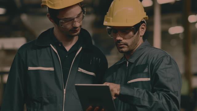 factory, use digital tablet computer - building contractor stock videos & royalty-free footage