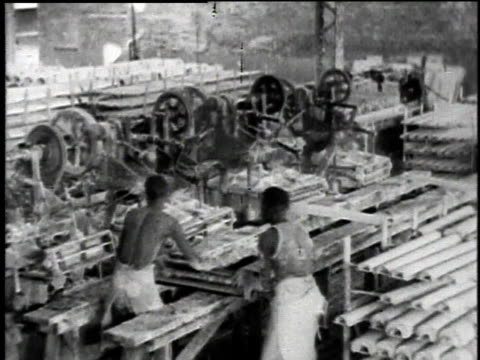1921 montage factory where limestone is being processed into lime and magnesia / united states - 1921 stock videos & royalty-free footage