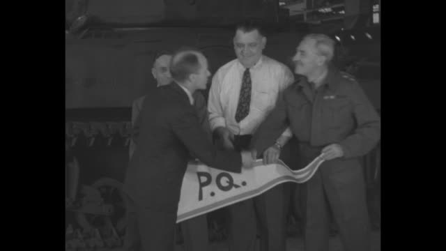 vídeos y material grabado en eventos de stock de factory with female workers / group of managers and one military officer, with pennant pq, province du quebec, shaking hands / men shaking hands /... - escarapela