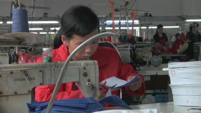 MS Factory worker at sewing machine / Yangzhou, Jiangsu, China