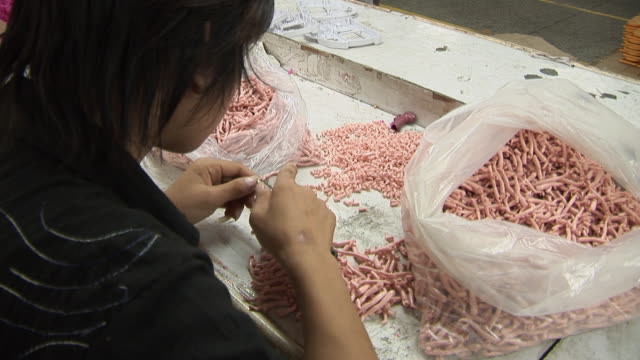 ms factory worker cutting excess plastic off of doll parts with a penknife/ dongguan, china - penknife stock videos & royalty-free footage