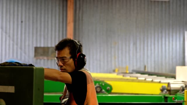 factory worker operates the machinery - timber yard stock videos & royalty-free footage