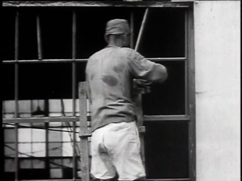 factory worker operating machinery / construction worker repairing windows / worker shoveling coal / worker building interior wall - 1947 stock videos & royalty-free footage