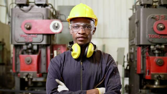 factory worker portrait look at camera - metal industry stock videos & royalty-free footage