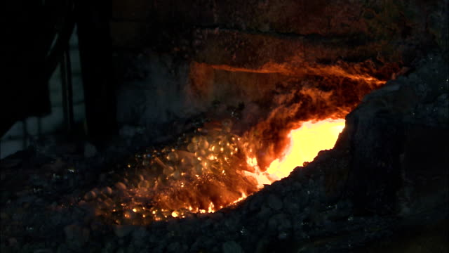 a factory worker pours sand into a brick furnace. - hearth oven stock videos & royalty-free footage